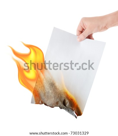burning paper in hand on white background - stock photo