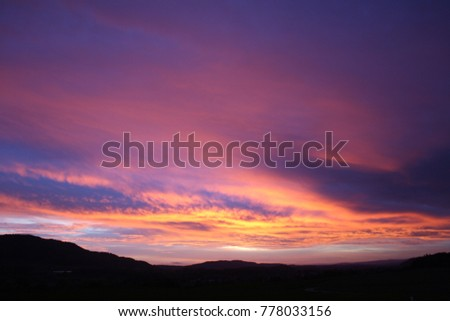 burning sky evening red heavy clouds chemical purple sky