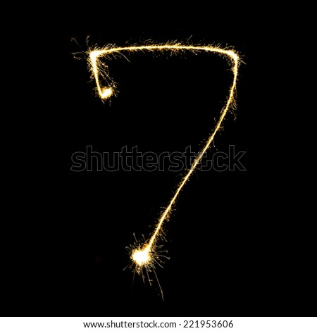 burning sparkler stick and writing sparkling text . number seven  isolated on black background - stock photo