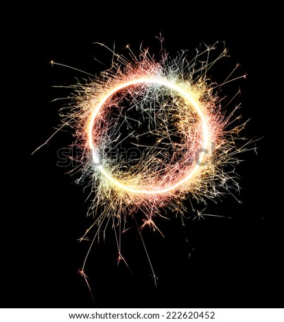 Burning sparklers isolated on black background. Small fireworks giving off sparks of fire. Sparks explosion. High resolution. - stock photo