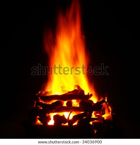 burning woods in a fireplace over black background