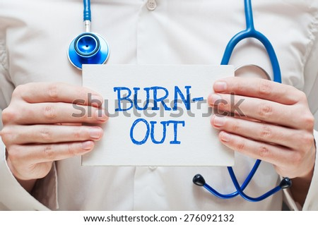 Burnout Written on a Card in Hands of Medical Doctor - stock photo