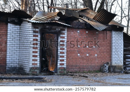 burnt house after the fire - stock photo