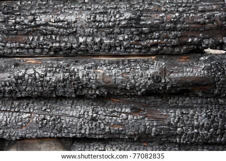 Burnt log wall - stock photo