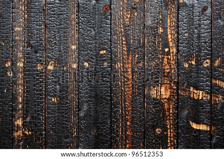 Burnt wood background texture - stock photo