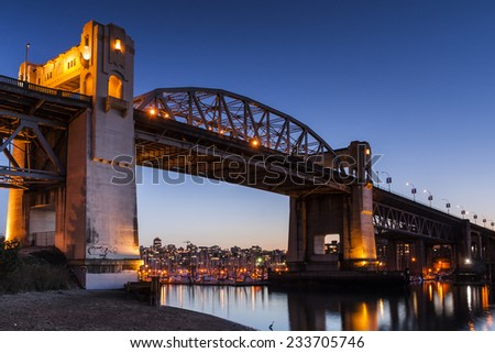 Burrard Street Bridge at dusk in Vancouver, British Columbia - stock photo