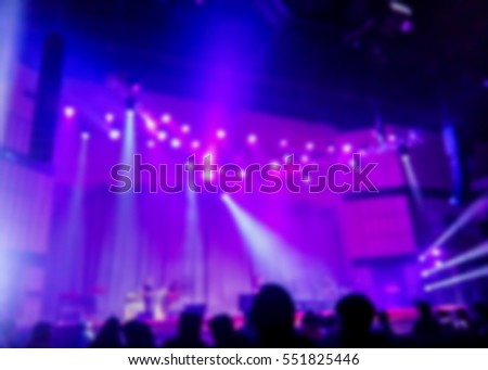 burred image of music concert stage with nice color light, can be used  for decoration or background