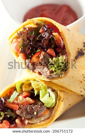 Burrito with Meat and Vegetables - stock photo