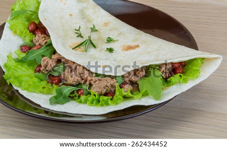 Burrito with tuna, ruccola and red beans - stock photo