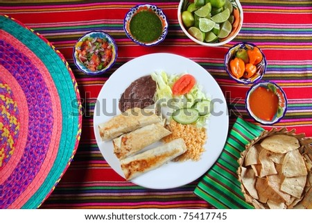 Burritos mexican rolled food rice salad and frijoles Mexico food - stock photo