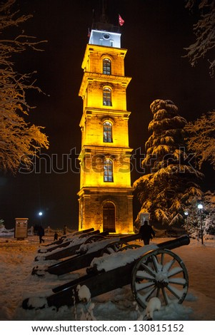 Bursa Clock Tower in the historic Tophane at night with Cannons