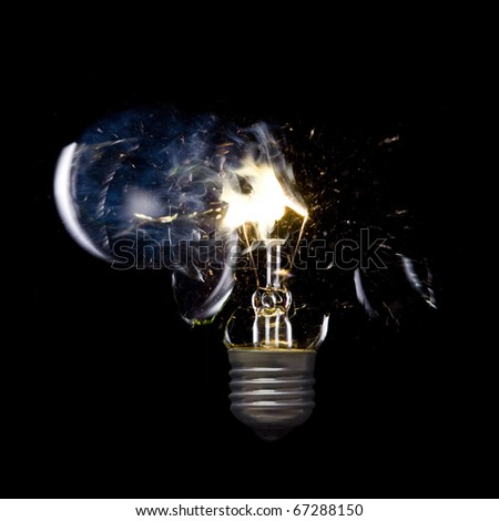 Bursting incandescent light bulb - stock photo
