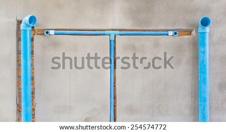bury a pvc pipe in the wall,sanitary system installation - stock photo