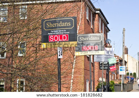 BURY ST EDMUNDS, UK- MARCH 10, 2014: Houses which have been sold in Bury St Edmunds, at a time when the local house prices are on the increase. - stock photo