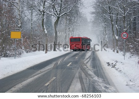 Bus at a slippery winter road - stock photo