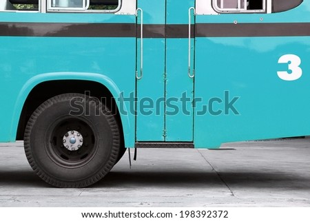 Bus, Autobus, School bus side view, wing with a wheel, Blue bus. - stock photo