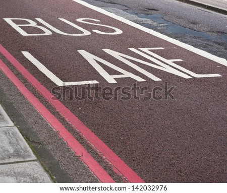 Bus lane road marking composition - stock photo