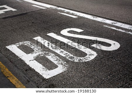 Bus Lane sign painted on to tarmac road - stock photo