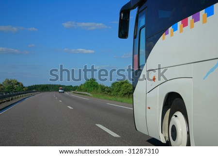 Bus riding fast on the highway - stock photo
