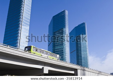 bus running on elevated highway with modern buildings in background, beijing, china.