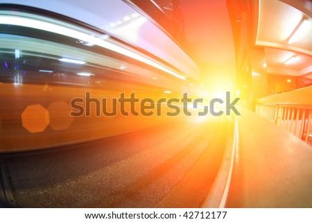 Bus speeding through city street. Abstract futuristic background - stock photo