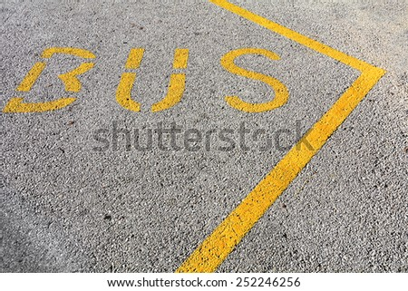 Bus stop sign pained on pavement - stock photo