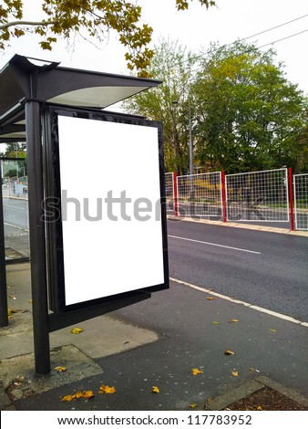 Bus stop with a blank bilboard - stock photo