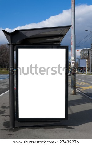 Bus stop with the blank billboard - stock photo