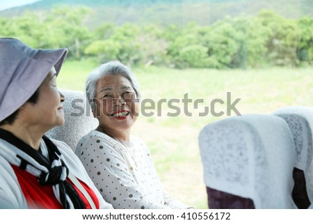 bus trip, elderly woman - stock photo