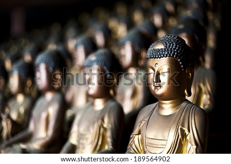 Busan South Korea, dozens of Buddhas inside the mountain Buddhist temple of Seokbulsa. - stock photo