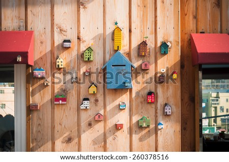 BUSAN, SOUTH KOREA - FEBUARY 26, 2015: Decoration wall at Gamcheon Culture Village, In 2009 South Korea launched a project to model the village into a creative community. - stock photo