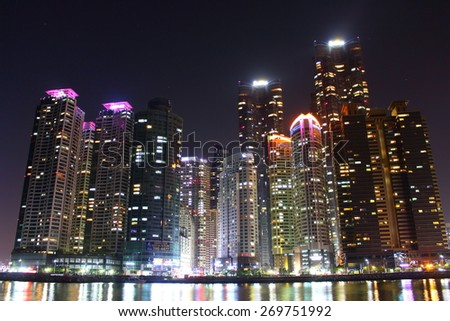 Busan, South Korea - March 26th of 2015: Night view of several buildings over the city's marine harbor.
