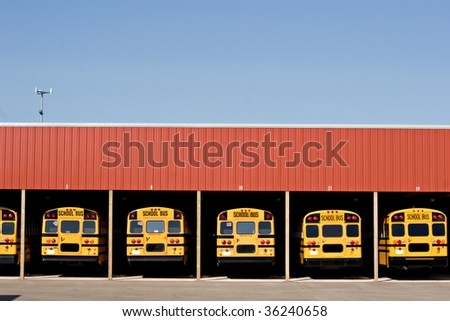 Buses in a garage - stock photo