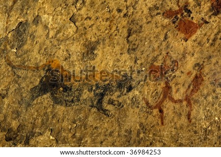 Bushman paintings, Lion  and bushman running, Eastern Cape, South Africa - stock photo