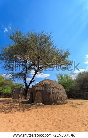 Bushman San people traditional huts in Kalahari Botswana. - stock photo