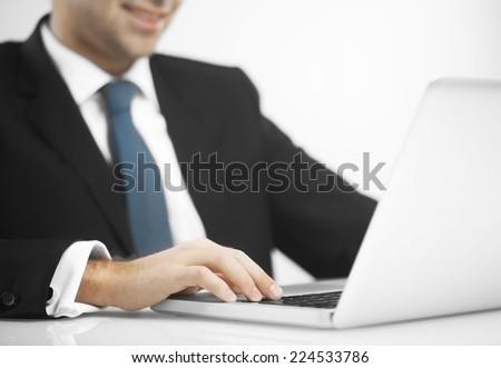 busienssman pushing keys of notebook, close up - stock photo