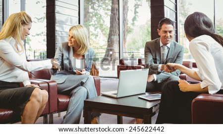 Busines people shaking hands after meeting in the office - stock photo