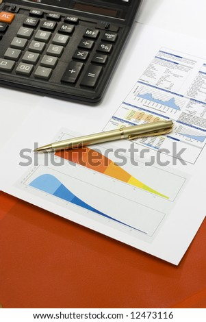 Business accessories on a background of diagrams and red file