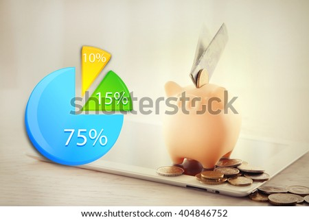 Business accounting concept.  Piggy bank with tablet and money on table indoors - stock photo