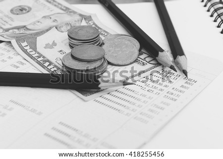 Business accounting, Pencil and Book bank statement money. Black and White