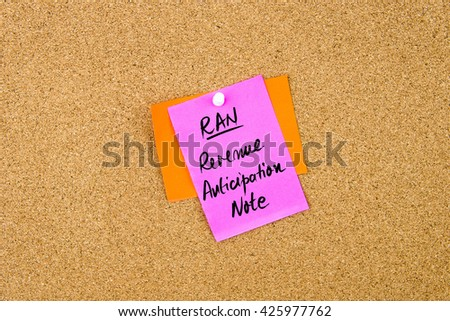 Business Acronym RAN Revenue Anticipation Note  written on paper note pinned on cork board with white thumbtack, copy space available - stock photo