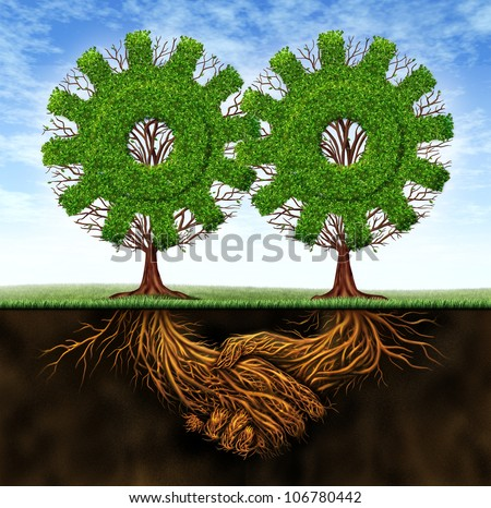 Business agreement and cooperation resulting in financial growth between two partners working together with the concept of two gear shaped trees with roots in the form of a hand shake. - stock photo