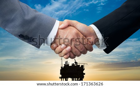 Business agreement on energy trade - stock photo