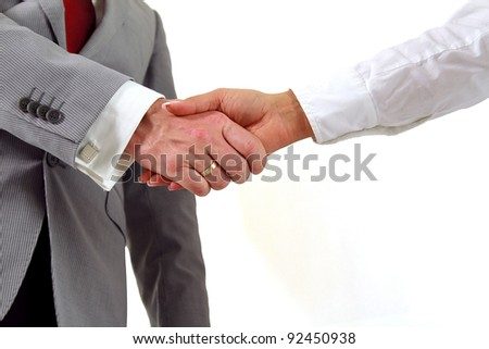 Business agreement with handshake - stock photo