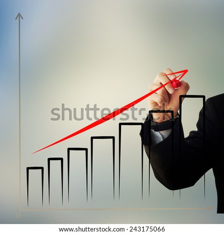 Business and advertisement concept. Close up of businessman drawing a graphic