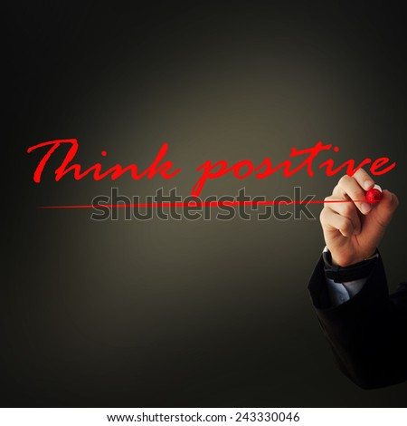 """Business and advertisement concept. Close up of businessman writing """"think positive"""" - stock photo"""