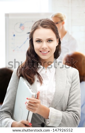 business and communication concept - businesswoman with laptop computer at work - stock photo