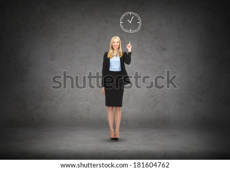 business and education concept - attractive young businesswoman with her finger up and wall clock - stock photo