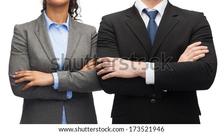business and education concept - smiling businesswoman and businessman with crossed arms - stock photo