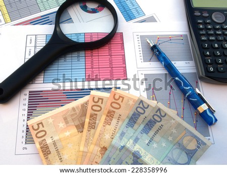 business and financial success concept: magnifier, calculator, bank notes, pen and documents  - stock photo